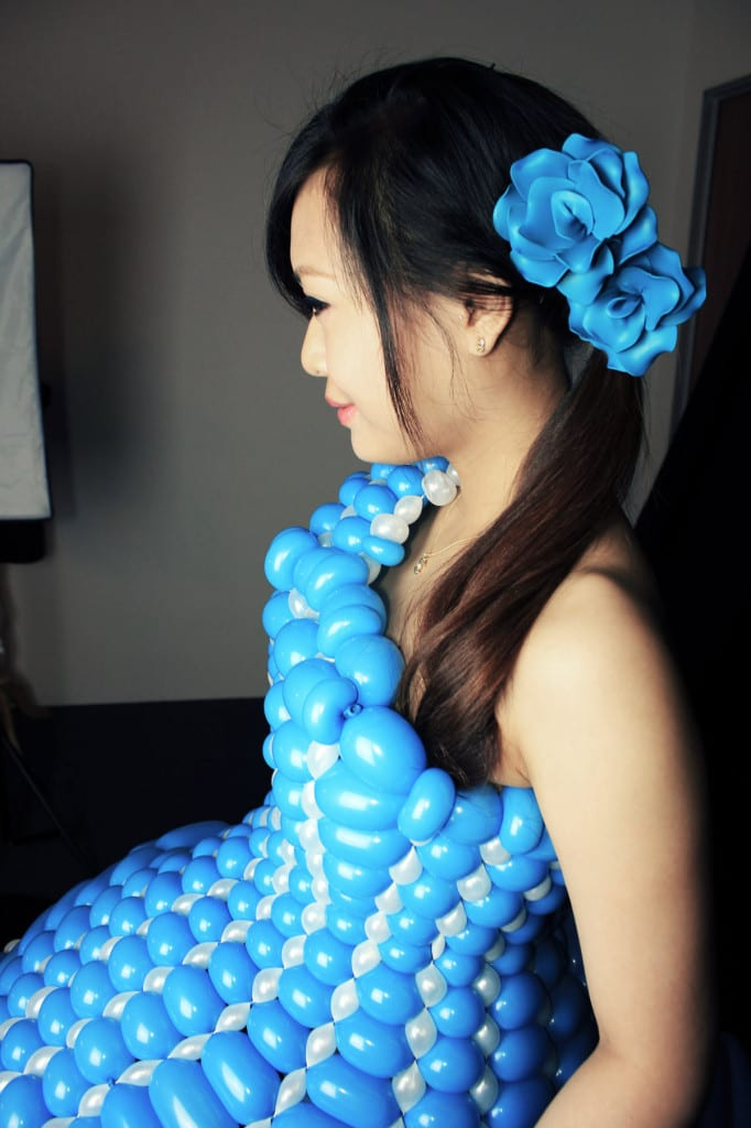 Blue dresswith fantasy flower head decor