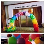 rainbow wedding arch with balloons